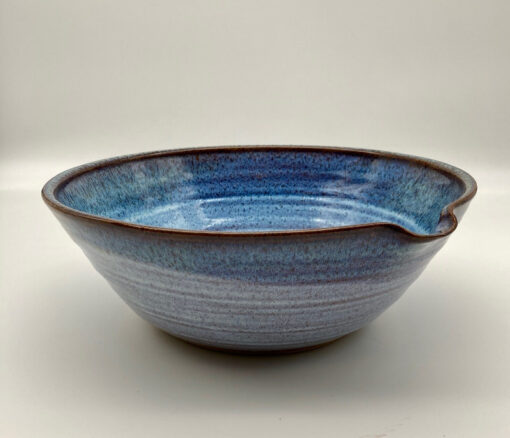 Large mixing bowl with spout in mist